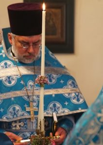 Father Arkady Mironko in blue vestments