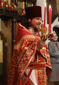 Father Nazari Polataiko in red vestments